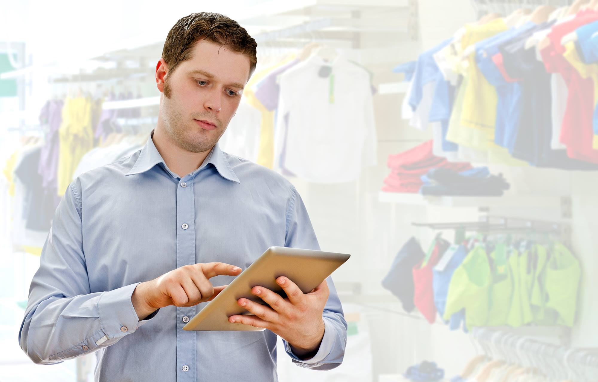 Supervisor with tablet pc in the clothing store